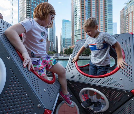 Children climbing out of a PlayCube playground structure